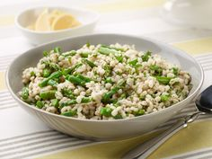 Slow-Cooker Asparagus-Barley Risotto : Food Network Kitchen's easy slow-cooker risotto will liven up your Easter spread and lighten your cooking load. This creamy rice dish is usually made withArborio rice, but we love it with the toothsome nuttiness (and fiber) of barley. Have your guests add a squeeze of lemon for an extra pop of brightness.