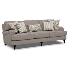 Blooming Style. Individually handcrafted, upholstered and tailored, the Candice sofa brings a one-of-a-kind look to your home. Using beautiful light gray upholstery, it provides a neutral backdrop for greens, browns and creams found in the stylish striped and floral accent pillows. Oversized English arms and loose back cushions make it the perfect place to stretch out or catch up. Built with stress-resistant bracing and premium padding, the sofa offers a long-lasting foundation with striking…