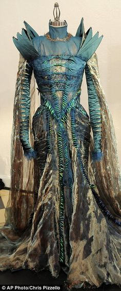 Gown worn by Charlize Theron in the film Snow White And The Huntsman, was made from discarded dung beetle shells that were purchased by the film's costume designer at a flea market in Thailand.    Dung beetles are commonly eaten in the country as a source of protein.    The shells had caught the designer's eye as she was searching for unique materials to create the film's costumes out of.    It is only seen in the film for a few seconds...
