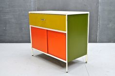 George Nelson for Herman Miller, a Steel Case series dresser cabinet in multi-coloured panels, c.1950s.