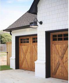 Modern garage doors, barn door garage, black garage doors, exterior b Garage Door Trim, Black Garage Doors, Modern Garage Doors, Garage Door Makeover, Front Doors, Barn Doors, Modern Farmhouse Exterior, Farmhouse Style, Metal Building Homes
