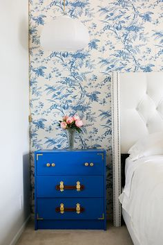 Chic blue wallpaper and matching nightstand chest