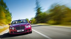 New Bentley Continental GT Speed Convertible in Magenta paint.