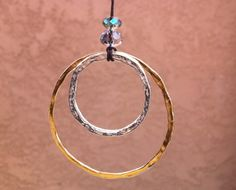 Good Circles! - My personal fave for the season - Sterling silver, gold vermeil and crystal beads on hemp cord.  Yes!