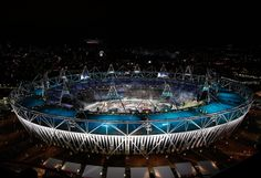 A helicopter flies above the olympic stadium as Team Great Britain walks in during the Opening Ceremony for the 2012 Olympic Games on July 27, 2012 at Olympic Park in London, England.
