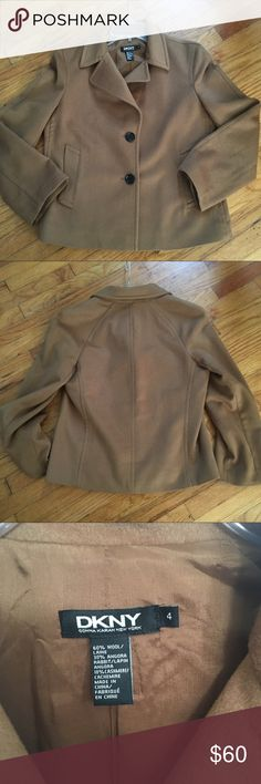 """DKNY Wool Camel Coat Gorgeous DKNY camel coat. It's 60% Wool, 30% Angora Rabbit, and 10% Cashmere. Women's size 4. Two front pockets. Measures 21"""" length. Sleeve is 21"""" and chest is 18 1/2"""". DKNYC Jackets & Coats Pea Coats"""