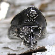 SMALL PIRATE SKULL RING http://www.thesterlingsilver.com/product/sterling-silver-fred-bennett-sapphire-detail-cufflinks/