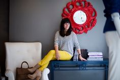 Yellow jeans, gray striped shirt.  (I like the red clock, maybe do this outfit with a red purse?)