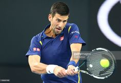 Novak Djokovic of Serbia plays a backhand in his third round match against Andreas Seppi of Italy during day five of the 2016 Australian Open at Melbourne Park on January 22, 2016 in Melbourne, Australia.
