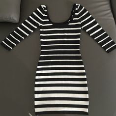 Black & White Party Dress Black & White Stripes • Form Fitting • Three Quarter Sleeves • Thicker, Cotton Fabric • Only Worn Once Charlotte Russe Dresses