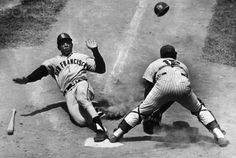 Original caption:5/30/1964-New York, NY- Slugger, Willie Mays, of the San Francisco Giants, slides into home plate safely after he tripled and came in when outfielder, Roy Macmillan of the New York Mets, dropped the outfield relay during the first inning of their game in  Stock Photo ID:  U1426897  Date Photographed:  May 30, 1964  Credit:  © Bettmann/CORBIS
