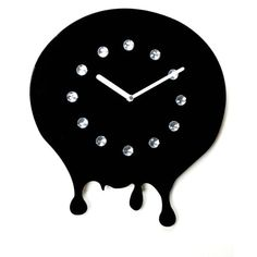 This fun clock features shiny rhinestone jewels and a dark black finish. Made from resin, keep the time in flashy style.