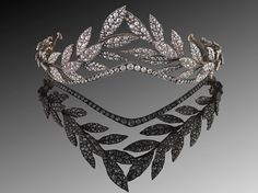 This 19th Century laurel leaf tiara can be worn in the traditional orientation with the leaves rising gently above the head, or it can be worn in a more modern fashion as a headband.
