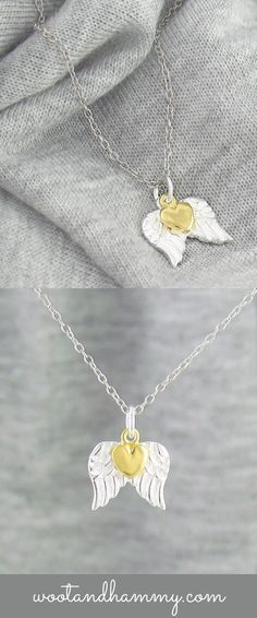 a pair of angel wings with a small gold heart charm...sterling silver necklace.