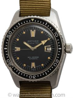 Gotham Stainless Steel Swiss Skin Diver 900, circa 1960's. Large and thick 40 x 50mm case, screw down case back with rotating elapsed time bezel. Great looking black original dial with applied silver indexes and beautifully patina'd luminous indexes with matching eccentric diver's hands. Dial signed Skin Diver 900 and Ball Bearing Automatic. Self winding movement with sweep seconds and date and screw down crown. Shown on 1 piece NATO style strap. Great looking sport model.