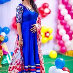 Dark Blue  color anarkali pattern  of neck and  sleeves  with mirror  work