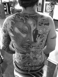Buddha head backpiece tattoo on Eric started at Lucky's in San Diego Ca - Luke Wessman - Self Made Tattoo Artist.