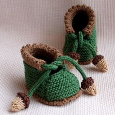 Knitted acorn baby booties ;These would be fun for adults too .