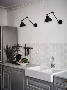 Black Wall Sconces, White Subway Tile, Gray Cabinets in Gray Scandinavian Kitchen Design ideas