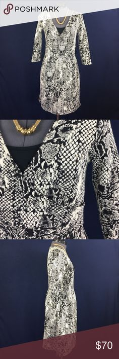 """HD in Paris """"Textured Wrap Dress"""" from Anthro """"Every closet needs a throw-on-and-go, Jill-of-all-trades dress."""" -Anthro. Thick textured material with a black & white print. Mock wrap bodice, HAS POCKETS! 58% cotton, 40% polyester, 2% spandex, very stretchy. 3/4 length sleeves. Size XS, but runs a bit big so could fit a Small well. Bust measured flat across is approx. 16.5 inches, but runs larger because of the wrap front. Back of neck to hem is 33.5 inches. I'm 5'4"""" and it hits right above…"""