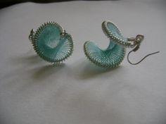 An interesting twist to Peruvian string earrings.