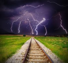 Railroad tracks and lightning..cool shot!