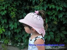 girl's hat with a hold for the ponytail