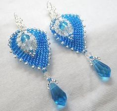 """Pretty blue leaf shaped danglers with crystal drops and a little silver accent""""The leaves are handwoven one bead at a time with the best seed beads and crystals.The leaves hang about an inch and half fron the end of the ear wires.The french earwires add to the beauty with a small flower at the end"""""""