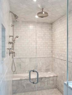 Suzie: Pickell Architecture - Seamless glass shower with marble bench, marble subway tiles ...
