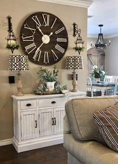 Beautiful giant wooden farmhouse clock. Makes for a great centerpiece on a wall and if decorated right, can really tie an area together. Perfect for the living room or family room.