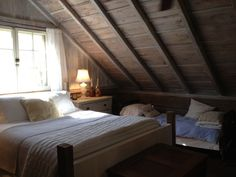 Upstairs cabin bedroom, vaulted ceiling (Coyote Creek Farm, OH)