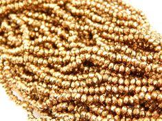 cristal checo 4mm, color dorado, tira con 150 piezas(especial), $26, precio especial a mayoristas. CODIGO: CC4M035