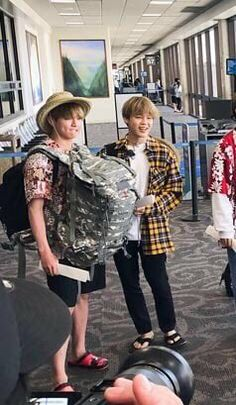 Jungkook carrying Jimin's bag and his own while in Hawaii.. Boyfriends