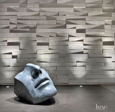 Modern Faceted Limestone Wall with Sculpture