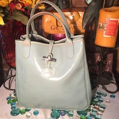 Longchamp Leather Tote Longchamp Small Tote- Sz 10x5x10- Light blue- Genuine leather- Interior in decent condition- Some wear & discoloration- In mint to decent condition.- Very nice bag! Longchamp Bags Totes