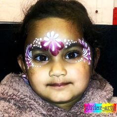 cute little girls face painting at a charity event