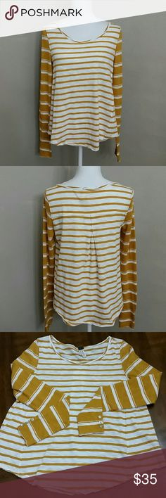 NWOT Free People Oversized Long Sleeve Stripe So cute! Breastline across laying flat measures 18.5 and length is 21.5 on shorter sides, an inch an a half loner through middle. Hems are signature raw after sewn. Button on sleeves and tucked/pleated middle on backside. 100% cotton. Could fit up to small or medium in my option. Urban Outfitters. Never worn. Nwot. Free People Tops Tees - Long Sleeve