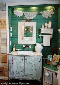 A really nasty old bathroom got remodeled with all salvaged elements - reclaimed wood on the walls, an antique dresser turned into a sink, antique sheet music turned into wallpaper and much more.  See the before & after via KnickofTimeInteriors.blogspot.com