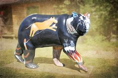 Legends Bear. This is the Legends Bear, painted by Henrietta Lambert and is part of Cherokee's Painted Bears. The Cherokee Bear Project was started in 2005 to showcase the talent of many Eastern Band of Cherokee artists in the Qualla Boundary. They are painted fiberglass bears set up in Cherokee, North Carolina. Each bear is colorful and represents a part of the Cherokee culture. I used texture and blurred the background so that these beautiful bears standout. I am the photographer and not…