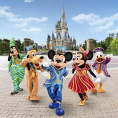 Mickey & Friends nearby Cinderella Castle at the Magic Kingdom in Tokyo Disneyland Resort sporting amazing outfits
