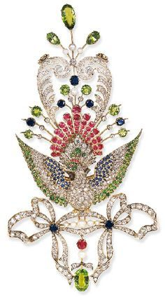 AN UNUSUAL ANTIQUE DIAMOND AND GEM-SET PEACOCK BROOCH Centering upon an old European-cut diamond peacock with pavé-set demantoid garnet head enhanced by circular-cut ruby crest and cabochon ruby accent eye...circa 1890