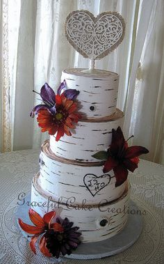 Rustic Birch Bark Wedding Cake with Purple and Orange Lilies and Gerberas
