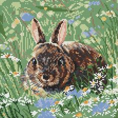 Pictured in its natural habitat, this wonderful woodland bunny cross stitch kit has been designed by Pollyanna Pickering for Creative World Of Crafts.