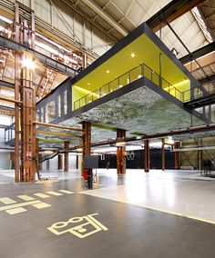 Completed in 2011 in Rotterdam, The Netherlands. Images by Theo Peekstok. In the heart of the ports of Rotterdam, Groosman Partners Architecten used a crane track in a former machine hall to suspend 1000 of office space. Industrial Architecture, Architecture Office, Architecture Design, Architecture Panel, Conception D'entrepôts, 25hours Hotel Hafencity, Design Commercial, Warehouse Design, Warehouse Office