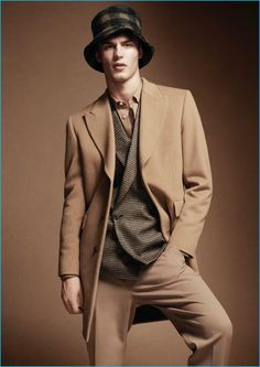 Appearing in a Wool editorial, Kit Butler sports a Paul Smith shirt, wool jacket, and trousers. Kit also wears a Maison Michel wool hat.