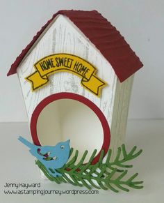 A cute birdhouse made with Stampin' Up! Home Sweet Home Thinlits and adorned with a cute bird from the Birds and Blooms Thinlits and some greenery from the Pretty Pines Thinlits. #stampinúpaustralia