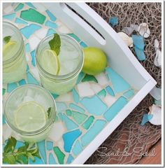 DIY Sea Glass Mosaic Tray - this tray with all the shades of turquoise, green, and blue seaglass is so pretty and easy to make. Click for a step by step tutorial.