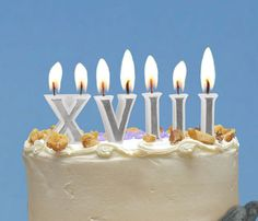oh i just love these roman numeral candles. this would make a birthday cake so much awesomer. a great take on a classic candle.