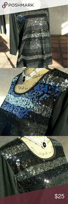"""177)Black top with sequins & lace overlay - NWOT Black  3/4 length sleeve top... the front is covered in sequins that are black, silver and pewter with a little lace overlay.....as you can see from the 2nd photo when certain light hits it the sequins look  blue, very cool....measures approximately 23"""" from armpit to armpit & approximately 28"""" from the shoulder seam to the hem.. small slits on the sides at the bottom..cotton/polyester blend...lace overlay is 100% nylon......tu5... Quacker…"""