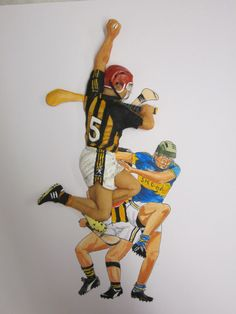 All Ireland Senior Hurling Final between Kilkenny & Tipperary. Magazine Page Layouts, Page Layout Design, Sports Stars, Prehistoric, Tigger, Sculpting, Ireland, Daddy, Paintings